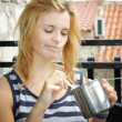 Stock Photo: Woman eating awful soup from pot
