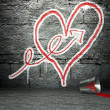 Graffiti wall with arrow and heart sign, street background — Stock Photo