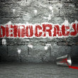 Graffiti wall with democracy, street background - Stock Photo
