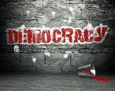 Graffiti wall with democracy, street background — Stock Photo