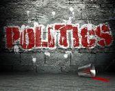 Graffiti wall with politics, street background — Stock Photo