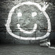 Graffiti wall with smile face, street background — Stock Photo #18650007