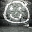 Graffiti wall with smile face, street background — Stock Photo