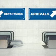 Moving escalator stairs, arrivals departures sign — Stock Photo
