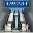 Moving escalator stairs in airport, arrivals sign — Stock Photo #19732311