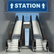 Moving escalator stairs in building, station sign - Stock Photo