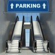 Moving escalator stairs in building, parking sign — Stock Photo