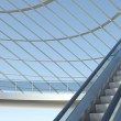 Moving escalator and modern office building — ストック写真