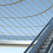 Moving escalator and modern office building — Stockfoto