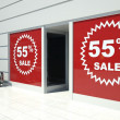55 percent sale on shopfront windows and escalator — Stock Photo