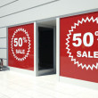 50 percent sale on shopfront windows and escalator — Stock Photo