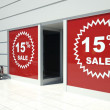 Royalty-Free Stock Photo: 15 percent sale on shopfront windows and escalator