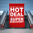 Hot deal offer advertising flag and escalator — Stock Photo