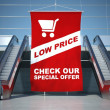 Low prices offer advertising flag and escalator — Stock Photo