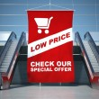 Low prices offer advertising flag and escalator - Stock Photo