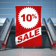 10 percent sale advertising flag and escalator — Stock Photo