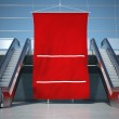 Blank advertising flag and moving escalator stairs — Stock Photo