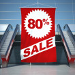 Stock Photo: 80 percent sale advertising flag and escalator