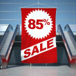 85 percent sale advertising flag and escalator - Stock Photo