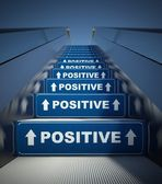 Moving escalator stairs to positive, concept — Stockfoto