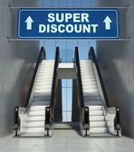 Moving escalator stairs in mall, super discount sign — Stock Photo
