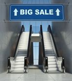 Moving escalator stairs in mall, big sale sign — Stock Photo