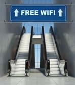 Moving escalator stairs in building, free wifi sign — Stock Photo