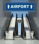 Moving escalator stairs in building, airport sign — Stock Photo