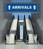 Moving escalator stairs in airport, arrivals sign — Stock Photo