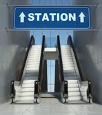 Moving escalator stairs in building, station sign — Stock Photo