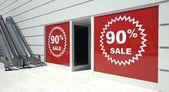 90 percent sale on shopfront windows and escalator — Stock Photo