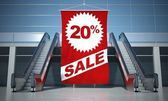 20 percent sale advertising flag and escalator — Stock Photo