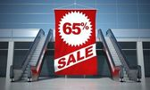 65 percent sale advertising flag and escalator — Stock Photo