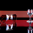 Стоковое фото: Glass of alcohol and sunglasses, disco background