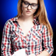 Calm young woman with nerd glasses learning diligently - Foto de Stock
