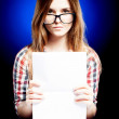Young girl with exercise book looking through the nerd glasses — Stock Photo