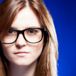 Closeup strict young woman with nerd glasses — Stock Photo #22472573