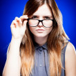 Young woman looking through the nerd glasses - Foto de Stock