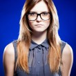 Strict young woman with nerd glasses - Stock fotografie