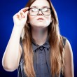Strict young woman holding nerd glasses — Stock Photo #22473149