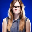Strict serious young woman with nerd glasses — Stock Photo #22473397