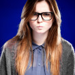 Strict young woman with nerd glasses and granny sweater - Stockfoto