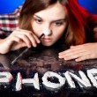 Woman snorting cocaine or amphetamines, phone addiction — Stock Photo #22476297