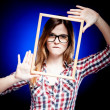 Woman with nerd glasses and frame around her face — Stock Photo #22476761