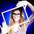 Woman with nerd glasses and frame around her face — Stock Photo #22476877