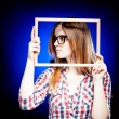 Woman with nerd glasses and frame around her face — Stock Photo #22476921