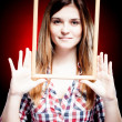 Young woman wearing plaid shirt holding wooden frame - Stock Photo