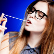 Portrait of strict young woman with nerd glasses and chewing gum - Foto de Stock