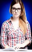 Calm young woman with nerd glasses learning diligently — Stock Photo