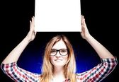 Woman with nerd glasses holding empty frame — Stock Photo